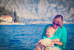 Mother and little daughter with seashell on Royalty Free Stock Photo