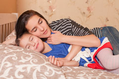 Mother and little daughter sleep in bed. Stock Photo