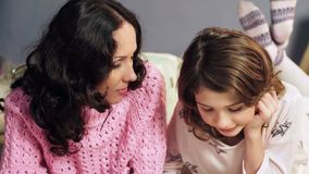 Mother and little daughter spending time together, chatting before bedtime stock images