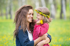 Mother and little daughter in spring park Stock Photography
