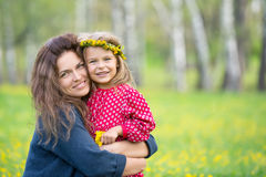 Mother and little daughter in spring park Royalty Free Stock Images