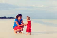 Mother and little daughter on summer beach Royalty Free Stock Images