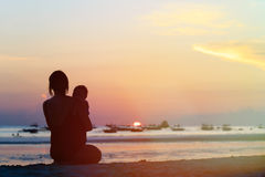 Mother and little daughter on sunset Royalty Free Stock Photography