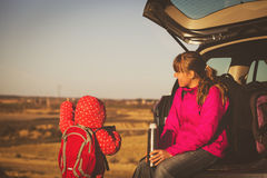 Mother and little daughter travel by car in mountains Stock Image