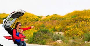Mother and little daughter travel by car Stock Image