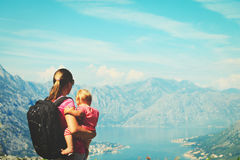 Mother with little daughter travel hiking in mountains Stock Photo