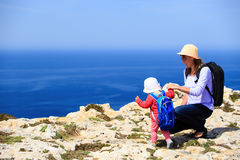 Mother and little daughter travel in mountains Stock Photo