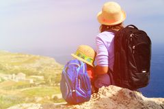 Mother and little daughter travel in mountains Stock Images