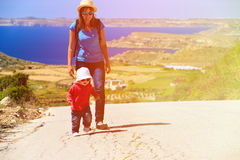 Mother and little daughter travel on scenic road. Family travel Stock Image