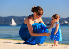 Mother and little daughter on tropical beach Royalty Free Stock Photos
