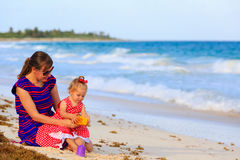 Mother and little daughter on tropical beach Royalty Free Stock Images