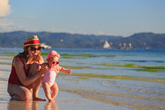 Mother and little daughter on tropical beach Royalty Free Stock Photography
