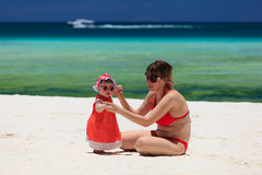 Mother and little daughter on tropical beach Stock Photo