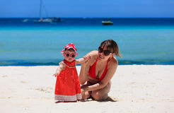 Mother and little daughter on tropical beach Royalty Free Stock Photo
