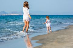 Mother and daughter walking on the beach. Mother and little daughter walking on the beach Stock Photography