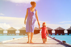 Mother and little daughter walking on beach report. Mother and little daughter walking on beach tropical report Stock Image