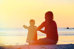 Mother and little daughter walking on beach at Royalty Free Stock Photography