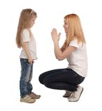 Mother and little daughter on white Stock Images