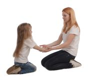 Mother and little daughter on white Stock Image