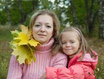 Mother with little girl Stock Images