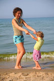 Mother with little girl on beach Royalty Free Stock Image