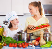 Mother and little girl cooking Stock Photo