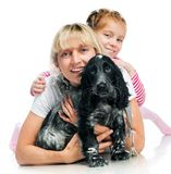 Mother and little girl with dog Stock Photos