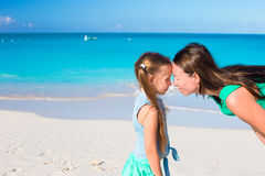 Mother and little girl have fun on summer vacation Stock Image