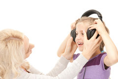 Mother and little girl with headphones Royalty Free Stock Photo
