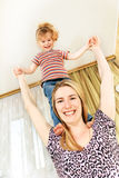 Mother and little girl on her shoulders Royalty Free Stock Photography