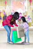 Mother and little girl hold shopping bag Royalty Free Stock Image