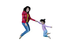 Mother and little girl jumping together Stock Photo