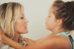Mother and little girl kid in studio. Stock Images