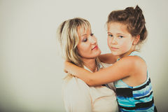 Mother and little girl kid in studio. Stock Photos