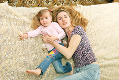 Mother and little girl laying down Stock Photo