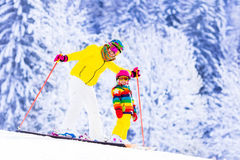 Mother and little girl learning to ski Royalty Free Stock Image