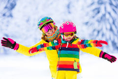 Mother and little girl learning to ski Stock Image