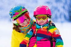 Mother and little girl learning to ski Stock Photo