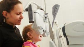 Mother and little girl - optometrist Checks Child`s Eye - Children ophthalmology Stock Photos