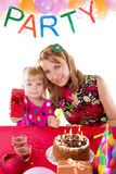 Mother and little girl at party table Stock Photos