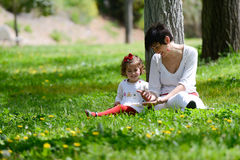 Mother and little girl playing in the park Royalty Free Stock Images