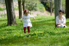 Mother and little girl playing in the park Royalty Free Stock Photography