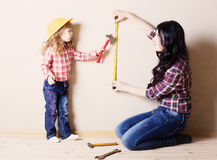 Mother with little girl plays in the builder Royalty Free Stock Photo