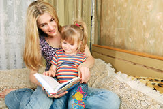Mother and little girl reading Royalty Free Stock Image