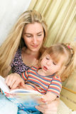 Mother and little girl reading Stock Image