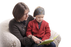 Mother and little girl reading a story Stock Photos