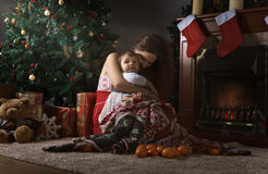 Mother with little girl  in the room with Christmas decorations Stock Photography