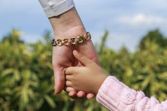 Mother and little girl's  hands Royalty Free Stock Photo