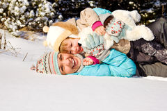 Mother and little girl in snow Royalty Free Stock Images