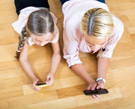 Mother and little girl social networking Stock Photography